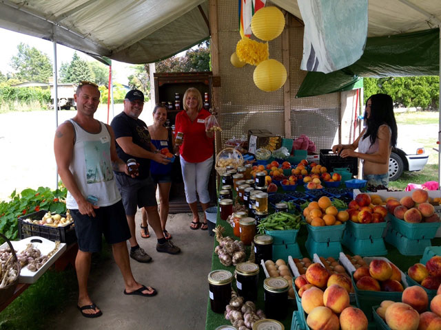 Group purchasing fruits while on Farm Tour